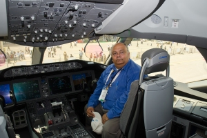 Devesh posing Inside Boeing 787 Dreamliner Cockpit